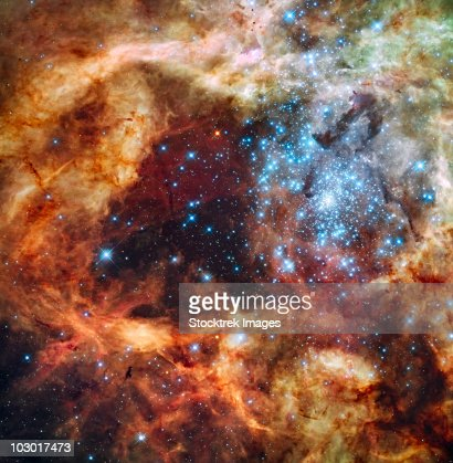A stellar nursery known as R136 in the 30 Doradus Nebula. : Stock Photo