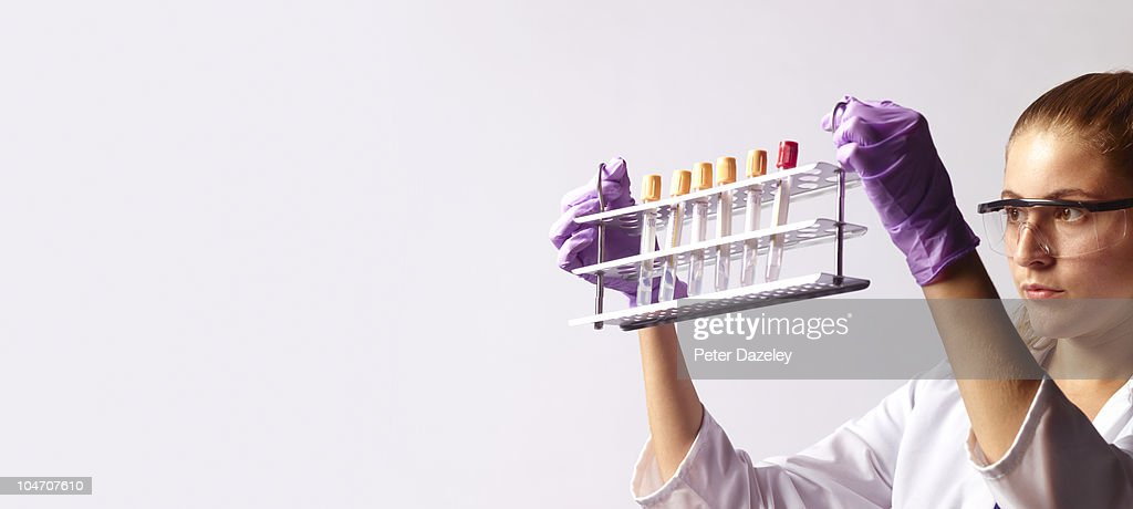 Stem cell scientist with rack of test tubes : Stock Photo