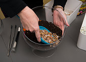 Step 3 Michele Weymouth adds another layer of pea gravel on top of potting soil while making a doityourself terrarium in Ashburn VA on January 12...