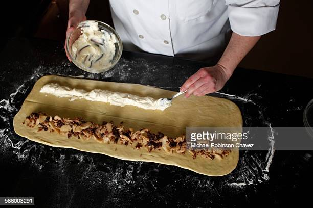 Step by step for making King Cake Repeat with the cream cheese filling down the other side