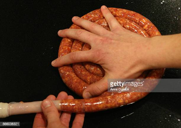 Step by Step to make Merguez 7 stuff sausage into sheep casing shot in the Los Angeles Times kitchen in Los Angeles on September 17 2009
