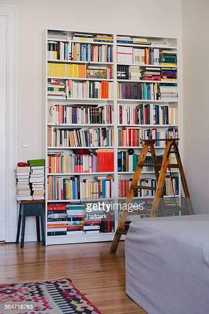 Step ladder near bookshelves at home