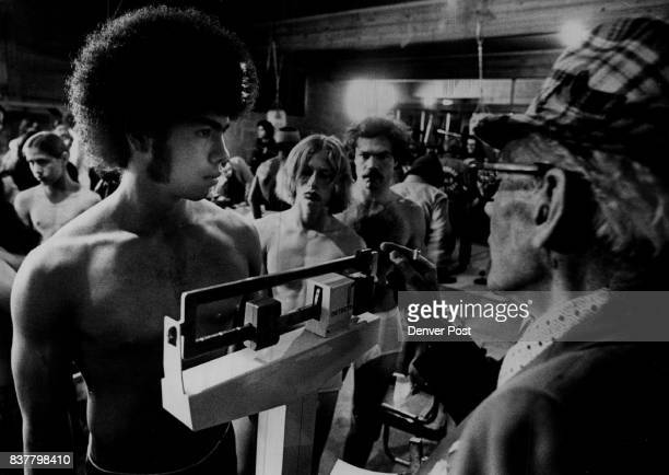 Step Right up and get Weighed in Ralph Blossom right checks the weight as Bernard Deleon of St Cajetan's watches Deleon weighed in at 156 pounds last...