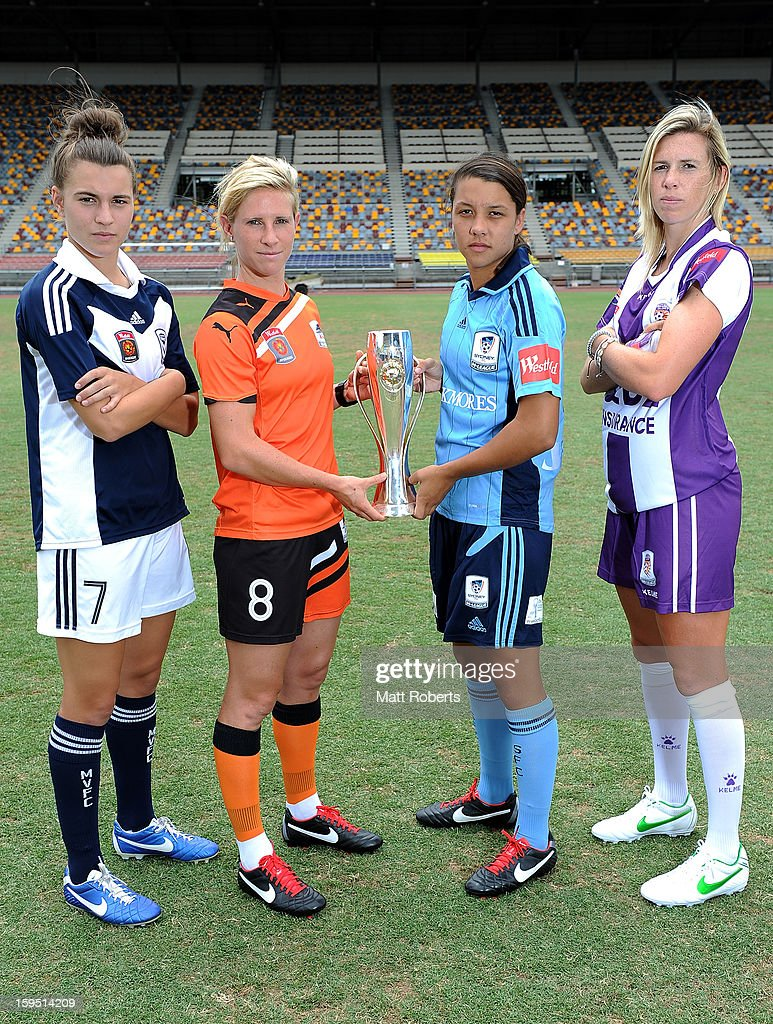 Stepahnie Catley of the Victory, Elise Kellond-Knight of the Roar, Samantha Kerr of Sydney FC and Carly Telford of the Glory pose with the W-League trophy during the W-League FFA finals series launch at Queensland Sport and Athletics Centre on January 15, 2013 in Brisbane, Australia.