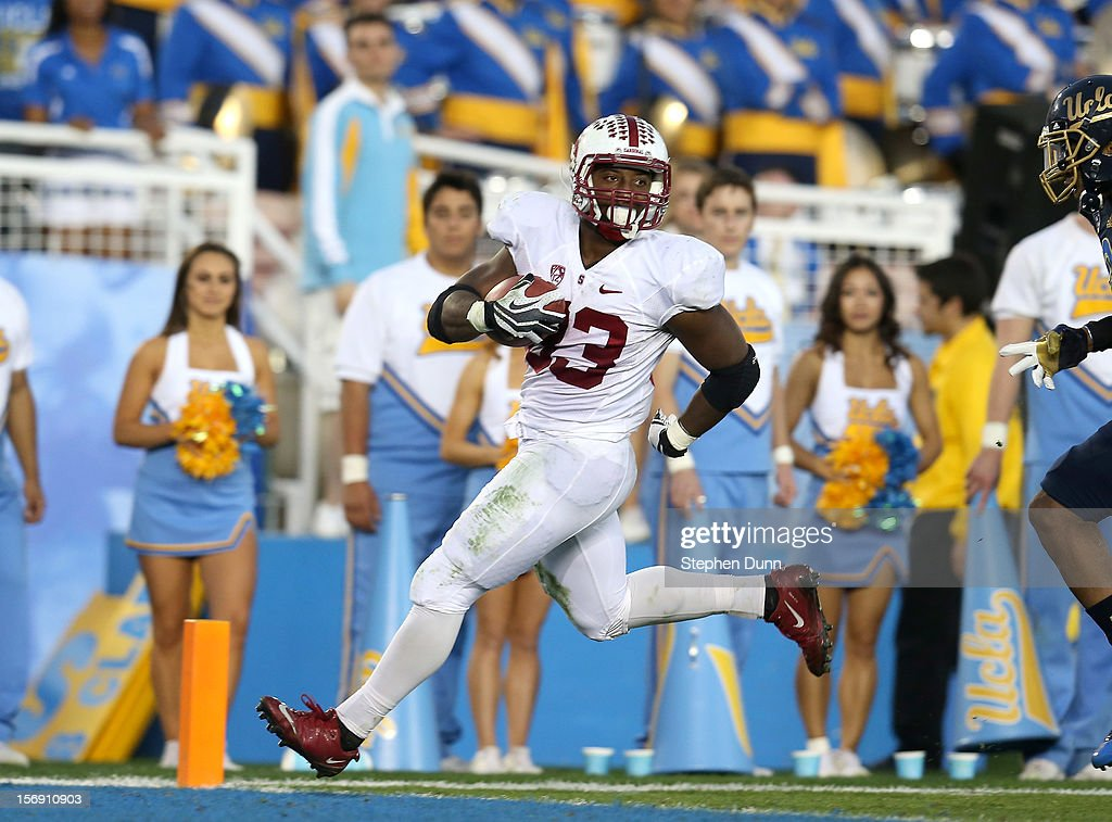 Stepfan Taylor #33 of the Stanford Cardinal crosses the goal line to complete a 49 yard touchdown run in the second quarter against the UCLA Bruins at the Rose Bowl on October 13, 2012 in Pasadena, California.