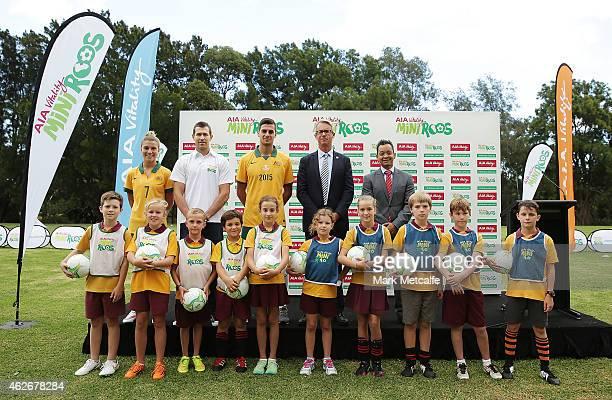 Steph Catley of the Matildas former Socceroo Brett Emerton Tomi Juric of the Socceroos FFA CEO David Gallop and AIA Australia CEO Damien Mu pose with...