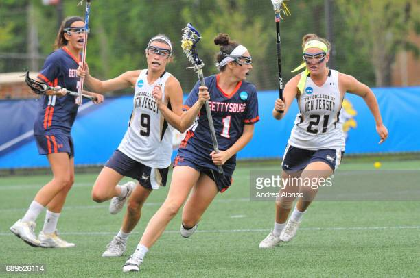 Steph Colson of Gettysburg College races past Erin Harvey and Brooke Lionetti of College of New Jersey during the Division III Women's Lacrosse...