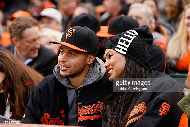 Steph Curry of the Golden State Warriors and his wife Ayesha watch the Atlanta Braves play the San Francisco Giants at ATT Park on May 29 2015 in San...