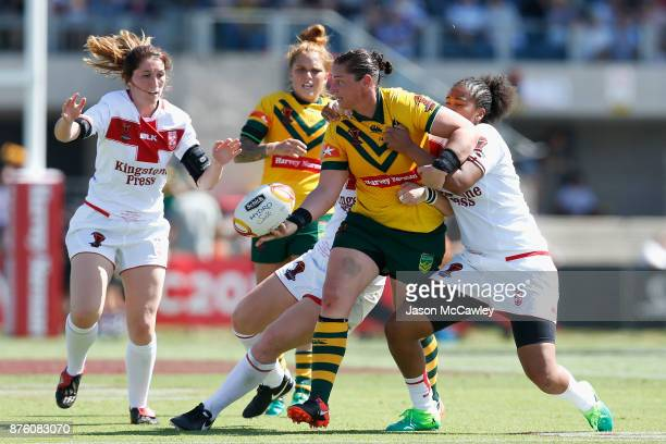 Steph Hancock of Australia passes during the 2017 Women's Rugby League World Cup match between Australia and England at Southern Cross Group Stadium...