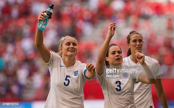 Steph Houghton and Claire Rafferty of England celebrate with fans after defeating Canada 21 in the FIFA Women's World Cup Canada 2015 Quarter Final...
