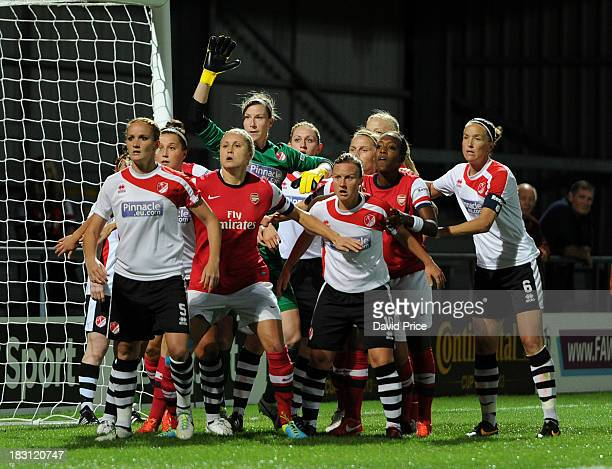 Steph Houghton and Danielle Carter of Arsenal Ladies suround Lincoln Goalkeeper Karen Bardsley during the match between Arsenal Ladies v Lincoln...