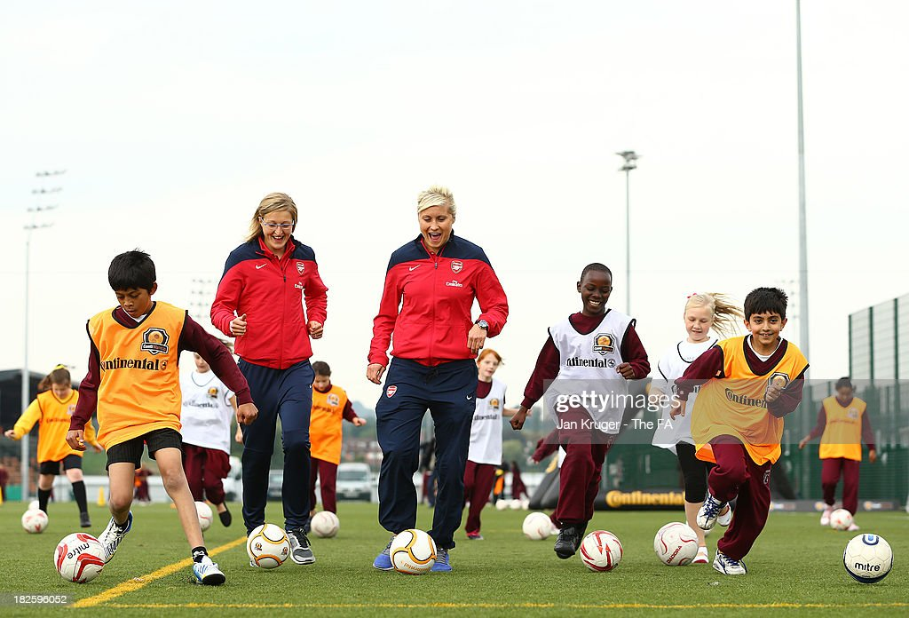 Steph Houghton and Ellen White join local children during the FA WSL Continental Cup Final Media Day at The Hive on October 1 2013 in Barnet England