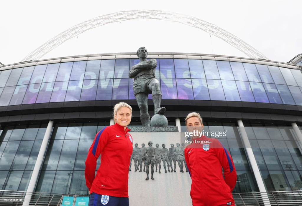 Steph Houghton (L) and Jordan Nobbs of England pose alongside the Sir Bobby Moore statue outside the stadium during an England Women Euro 2017 media day at Wembley Stadium on June 5, 2017 in London, England.