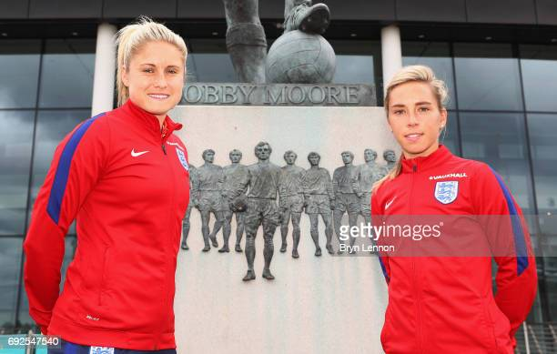 Steph Houghton and Jordan Nobbs of England pose alongside the Sir Bobby Moore statue outside the stadium during an England Women Euro 2017 media day...