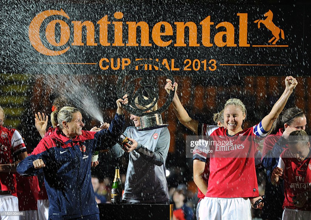 Steph Houghton and Kelly Smith of Arsenal Ladies lift the Contenental Cup after the match between Arsenal Ladies v Lincoln Ladies WSL Continental Cup Final at The Hive on October 4, 2013 in Barnet, England.