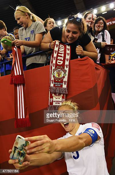 Steph Houghton captain of England makes a selfie with fans after the FIFA Womens's World Cup Group F match between England and Colombia at Olympic...