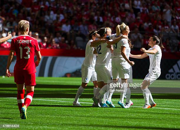 Steph Houghton celebrates teammate Karen Carney of England's goal against Canada during the FIFA Women's World Cup Canada 2015 Quarter Final match...