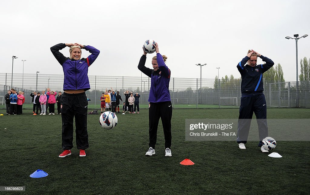 Steph Houghton, Kim Little of Arsenal Ladies FC and Siobhan Chambelain of Bristol Academy take part in a training session with local school children at Keepmoat Stadium on May 8, 2013 in Doncaster, England.