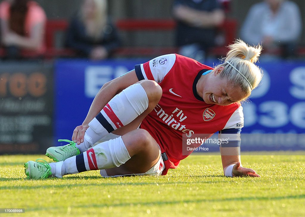 Steph Houghton of Arsenal holds her injured leg during the FA Women's Super League match between Arsenal Ladies FC and Chelsea Ladies FC at Meadow Park on June 6, 2013 in Borehamwood, England.