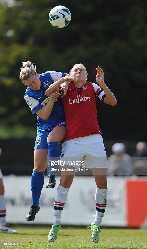 Steph Houghton of Arsenal Ladies FC challenges for a header with Rachel Hignett of Bristol Academy Women's FC during the FA WSL Continental Cup match between Arsenal Ladies FC and Bristol Academy at Meadow Park on May 19, 2013 in Borehamwood, England.