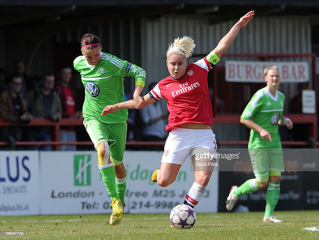 Steph Houghton (R) of Arsenal Ladies FC is pulled back by Viola Odebrecht of Wolfsburg during the Women's Champions League Semi Final match between Arsenal Ladies FC and VfL Wolfsburg at Meadow Park on April 14, 2013 in Borehamwood, United Kingdom.