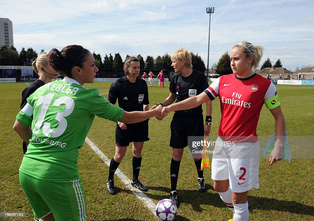 Steph Houghton (R) of Arsenal Ladies FC shakes hands with Nadine Kessler of Wolfsburg before the Women's Champions League Semi Final match between Arsenal Ladies FC and VfL Wolfsburg at Meadow Park on April 14, 2013 in Borehamwood, United Kingdom.