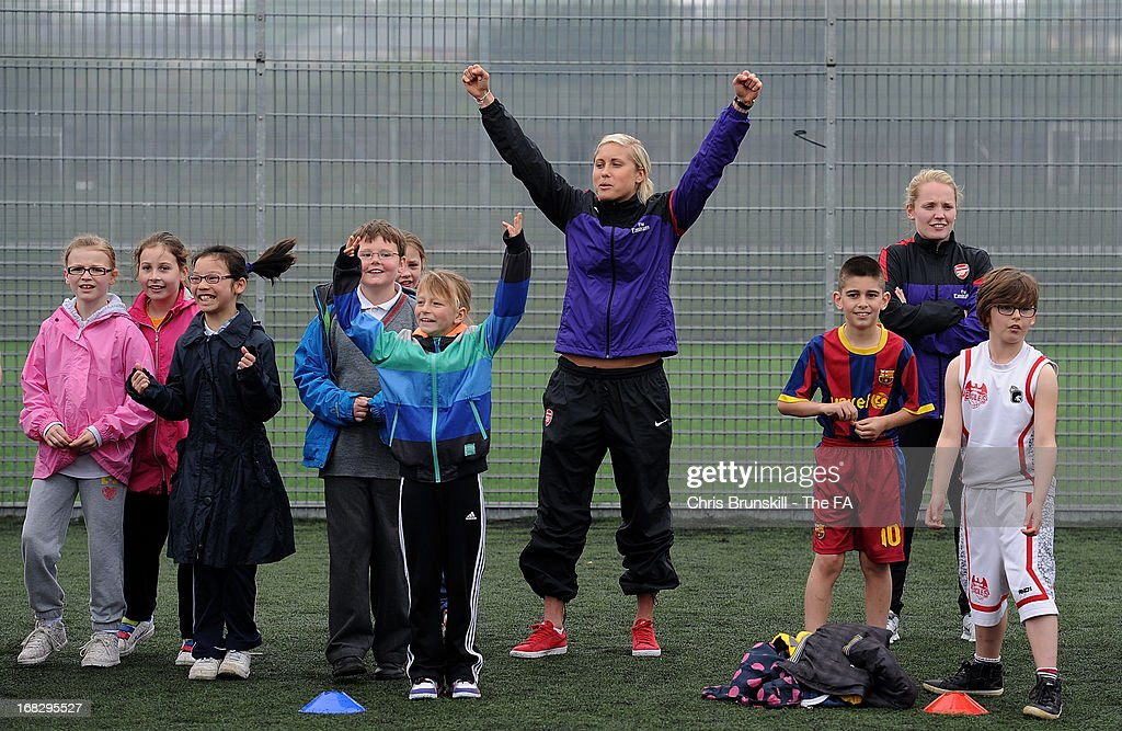 Steph Houghton of Arsenal Ladies FC takes part in a training session with local school children at Keepmoat Stadium on May 8, 2013 in Doncaster, England.