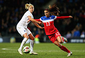 Steph Houghton of England and Alex Morgan of the USA challenge for the ball during a Women's International Friendly match between England and the USA...