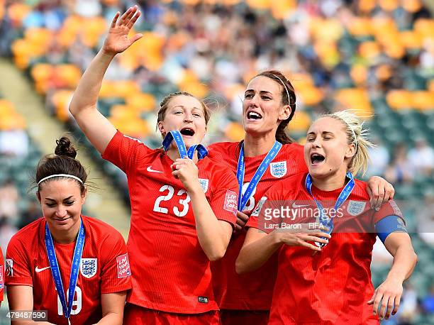 Steph Houghton of England celebrates with team mates Ellen White of England and Jill Scott of England after winning the FIFA Women's World Cup 2015...