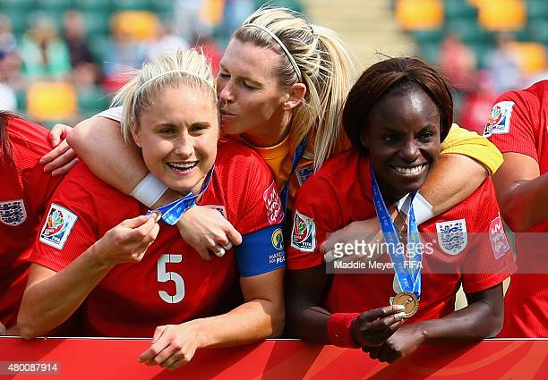 Steph Houghton of England Karen Bardsley and Eniola Aluko celebrate their third place win in the FIFA Women's World Cup 2015 third place playoff...