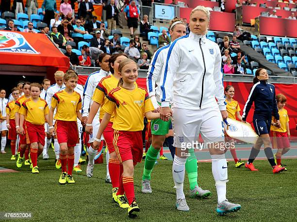 Steph Houghton of England leads the team out before the match against France during the FIFA Women's World Cup 2015 Group F match at Moncton Stadium...