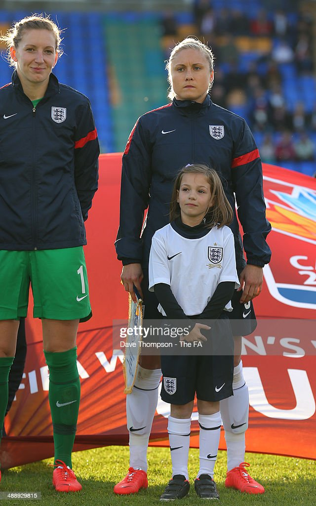 Steph Houghton of England lines up alongside Siobhan Chamberlain left and the match mascot before the FIFA Women's World Cup Qualifier between...