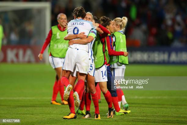 Steph Houghton of England Women picks up Jodie Taylor of England Women as the celebrate after the UEFA Women's Euro 2017 match between England and...