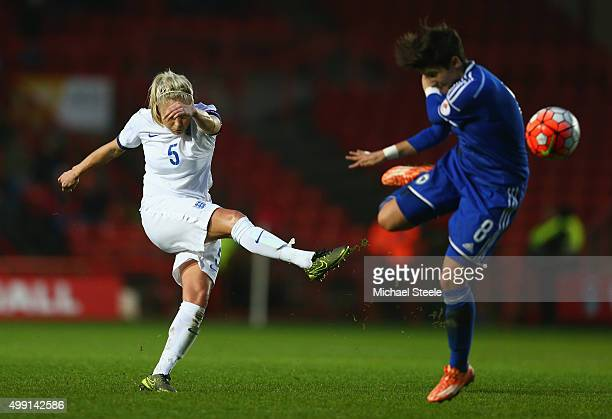 Steph Houghton of Englandshoots past Aida Hadzic of Bosnia and Herzegovina during the UEFA Women's Euro 2017 Qualifier match between England and...
