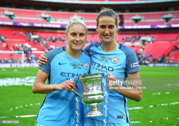 Steph Houghton of Manchester City and Jill Scott of Manchester City pose with the trophy after the SSE Women's FA Cup Final between Birmingham City...