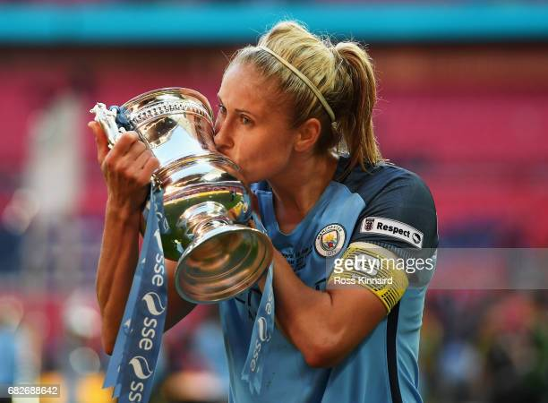 Steph Houghton of Manchester City kisses the trophy after the SSE Women's FA Cup Final between Birmingham City Ladies and Manchester City Women at...