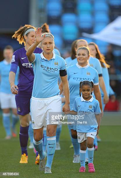 Steph Houghton of Manchester City leads out the teams with Sienna Kompany daughter of Vincent Kompany during the Women's Super League match match...