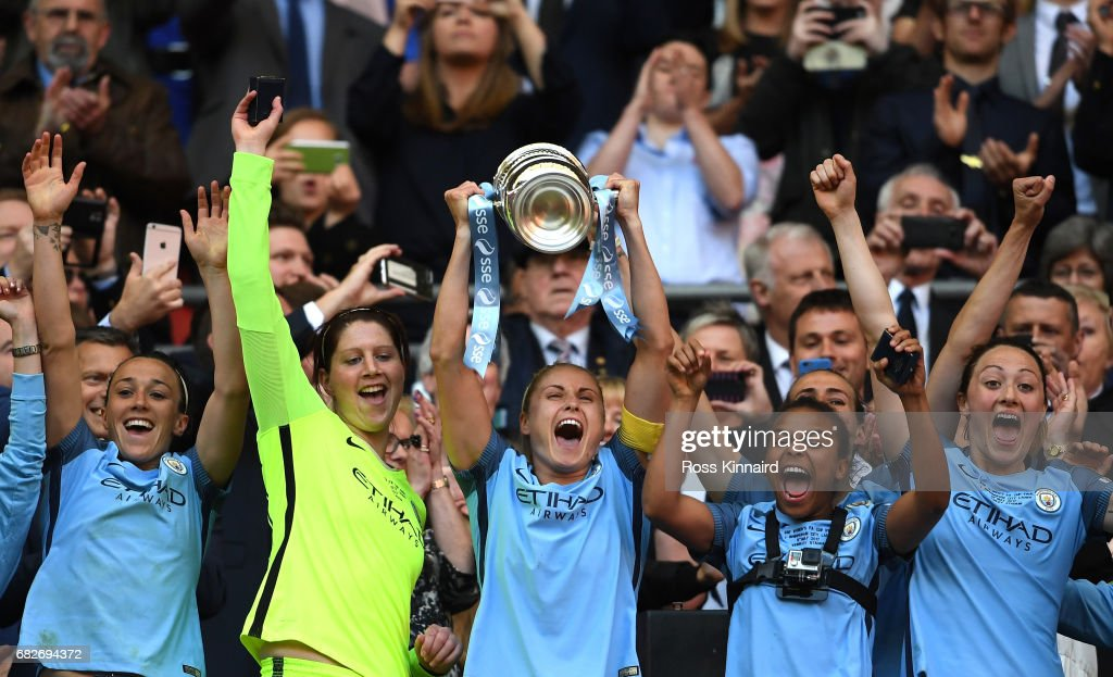 Steph Houghton of Manchester City lifts the trophy after the SSE Women's FA Cup Final between Birmingham City Ladies and Manchester City Women at Wembley Stadium on May 13, 2017 in London, England.