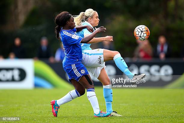Steph Houghton of Manchester City tackles with Eniola Aluko of Chelsea during the SSE Women's FA Cup Semifinal match between Chelsea Ladies FC v...
