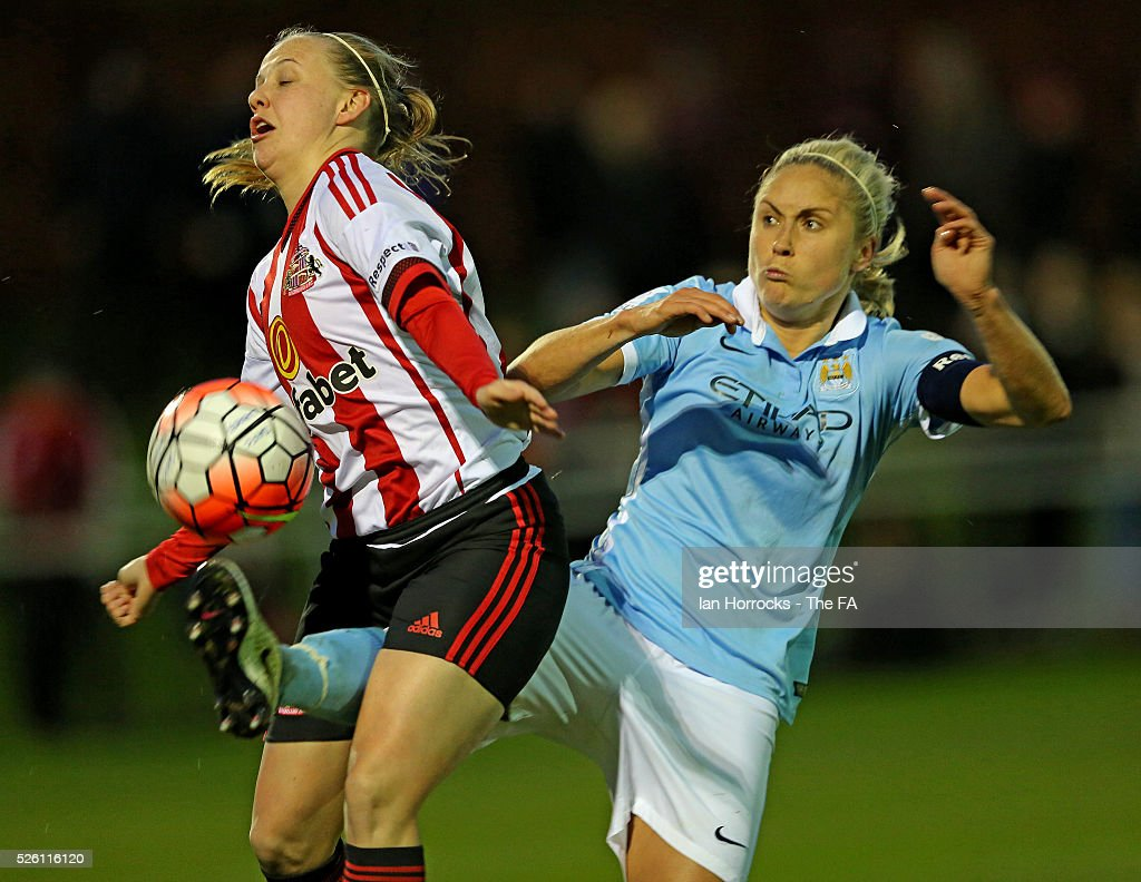 Steph Houghton of Manchester City tussles with Beth Mead of Sunderland (L) during the WSL 1 match between Sunderland AFC Ladies and Manchester City Women at The Hetton Center on April 29, 2016 in Hetton, England.