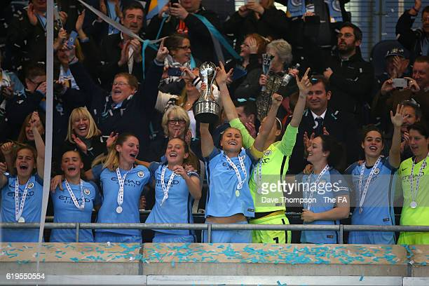 Steph Houghton of Manchester City Women lift the trophy during the WSL 1 match between Manchester City Women and Birmingham City Ladies at the...