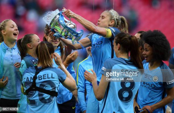 Steph Houghton of Manchester City Women throws champagne from the trophy over her team mates during the SSE Women's FA Cup Final between Birmingham...