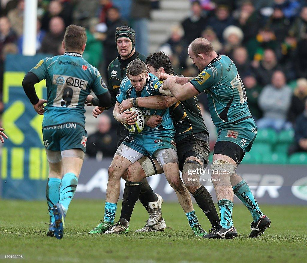 Steph Reynolds of Gloucester is tackled during the LV=Cup match between Northampton Saints and Gloucester at Franklin's Gardens on January 26, 2013 in Northampton, England.