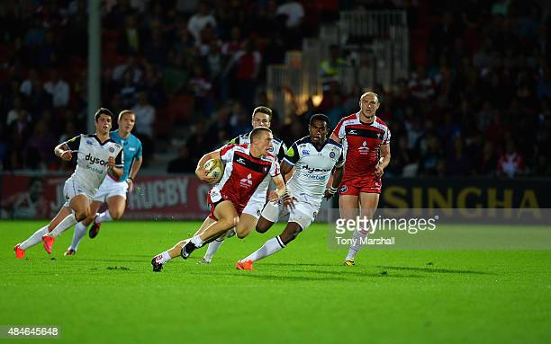 Steph Reynolds of Gloucester Rugby goes around of Apolosi Sokia of Bath Rugby on his way to scoring a try during the Singha Premiership Rugby 7s...
