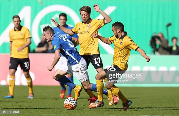 Stephan Andrist Andreas Lambertz and Fabian Mueller battle for the ball during the third league match between FC Hansa Rostock and SG Dynamo Dresden...