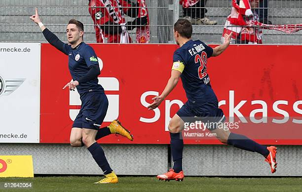 Stephan Andrist of Rostock jubilates after scoring the first goal during the third league match between FC Energie Cottbus and FC Hansa Rostock at...