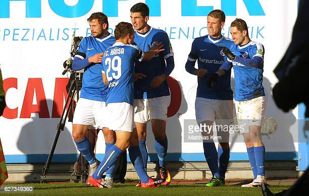 Stephan Andrist of Rostock jubilates with team mates after scoring the first goal during the third league match between FC Hansa Rostock and Holstein...
