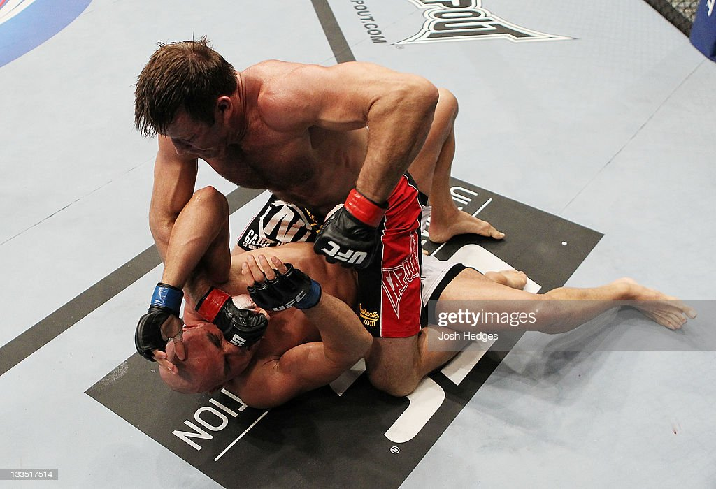 Stephan Bonnar (top) punches Kyle Kingsbury (bottom) during an UFC Light Heavywieght bout at the HP Pavillion on November 19, 2011 in San Jose, California.