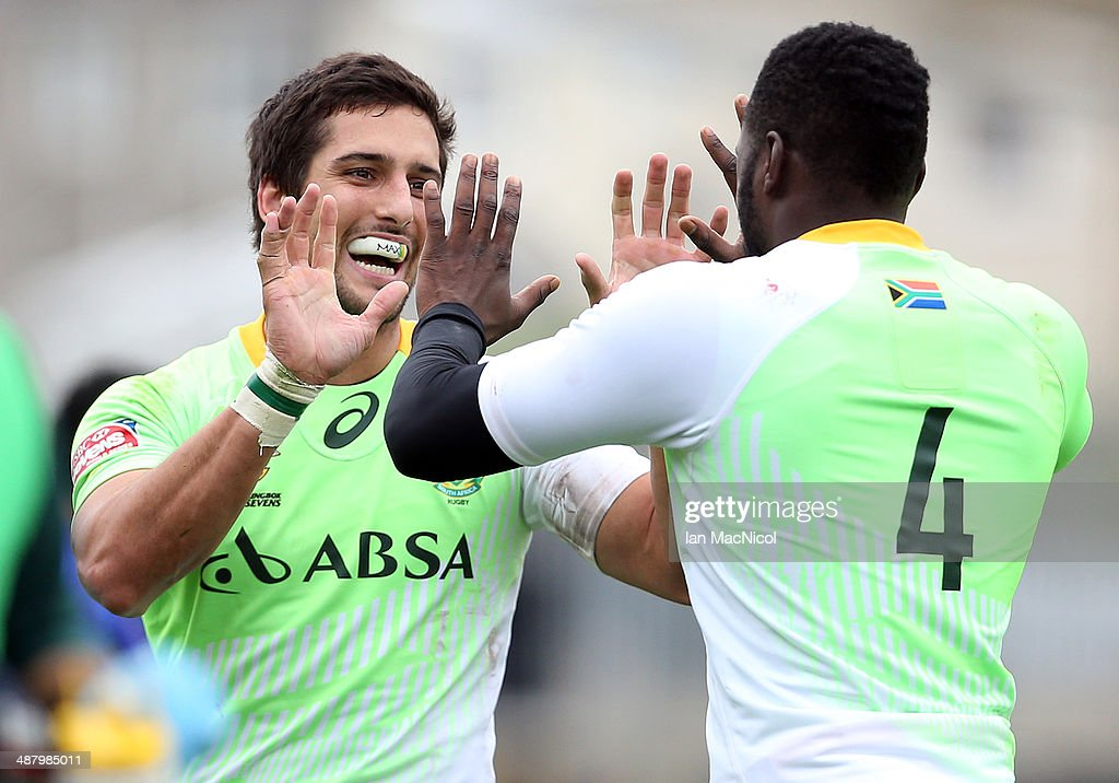 Stephan Dippenaar of South Africa celebrates with Jamba Ulengo of South Africa after his try during the game against Samoa during the IRB Glasgow Sevens at Scotstoun Stadium on May 3, 2014 in Glasgow, Scotland. (Photo by Ian MacNicol/Getty Images))