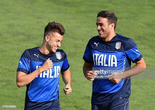 Stephan El Shaarawy and Alessandro Matri smile during the Italian training session at Coverciano on June 9 2015 in Florence Italy